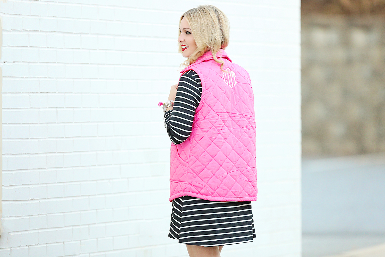 pink monogrammed vest and swing dress