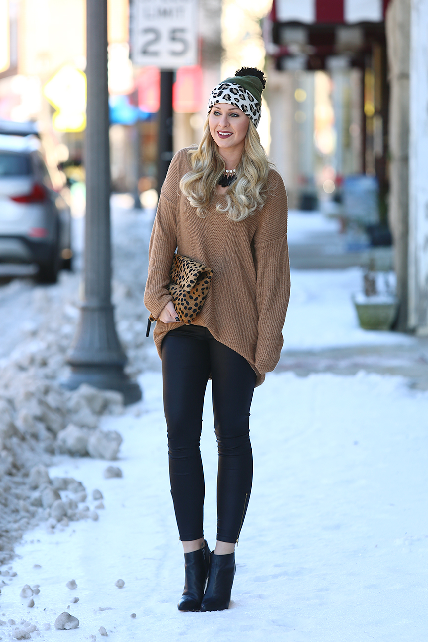 snow day look with leather leggings and leopard beanie with pom pom