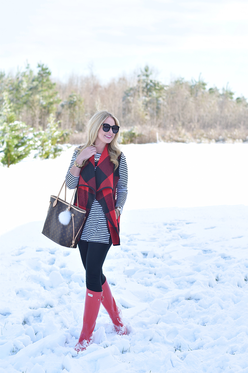 red plaid vest and hunter boots