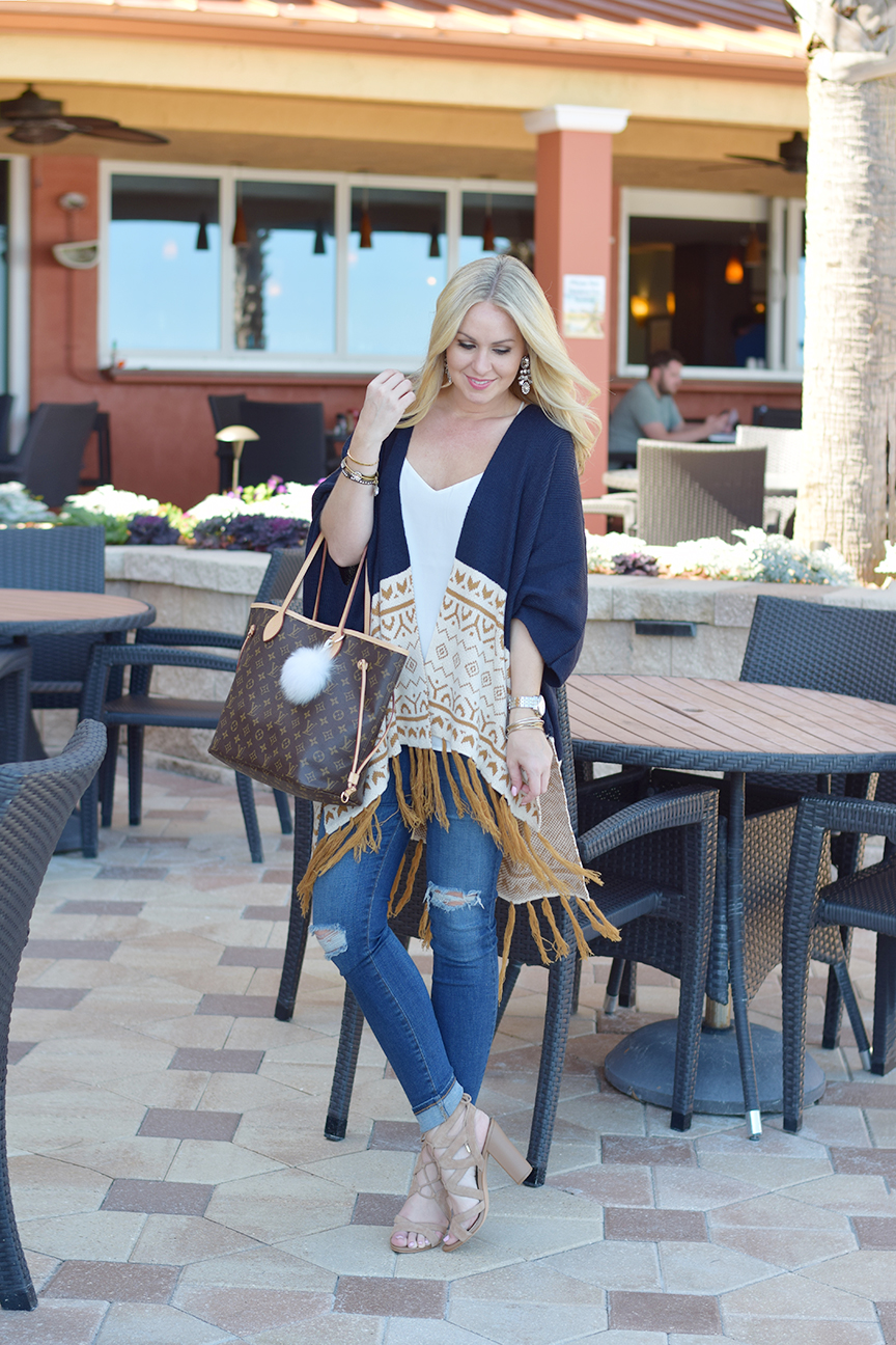 tan cape and ag skinny ankle jeans