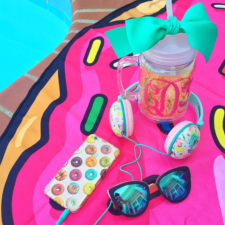 donut beach towel and phone case and quay cat-eye sunglasses