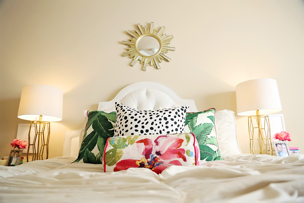 mixing palm leaf and dalmation print pillows